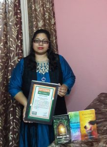 Reetwika with National Record certificate and her books
